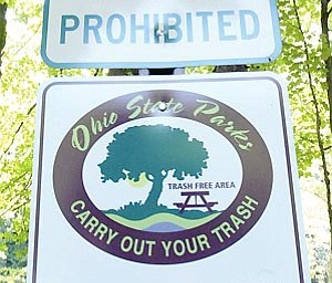 """""""Carry Out Your Trash"""" signs are on display at Beaver Creek State Park."""