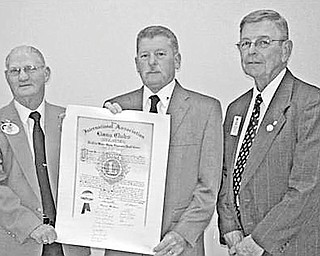 Special to The Vindicator CELEBRATION: A charter for the newly organized Streetsboro Lions Club is presented by District 13-D Governor Harold Ullman to Ed Lupton, president of the chartered club, as they are joined by Past District Governor Jerry Smith.
