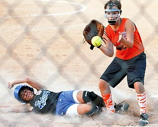 Poland's Arlia Duarte slides into home base before Howland's Navdia Pate can catch the ball during the second inning at the Field of Dreams in Boardman.
