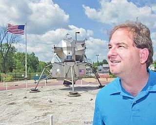 Dr. Patrick Durrell, YSU Professor of Astronomy, stands near replica of Lunar Lander in Warren.