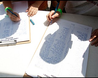 """7.16.2009 Scouts at at Camp Stambaugh on Thursday afternoon add their signature to those of others who have seen the 100 year commemorative mural, """"A Century of Values"""" during its journey to all Scout Camps across the country. Geoffrey Hauschild"""
