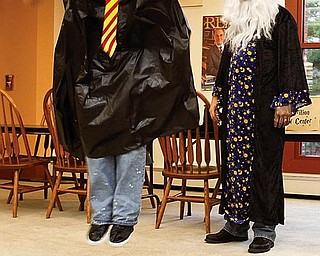 """WATCHFUL WIZARD: John Waller, a teen librarian dressed as the Albus Dumbledore character from the """"Harry Potter"""" book series, watches Justin Kalinary, 18, of Youngstown participate in an activity at the party at the Boardman library."""
