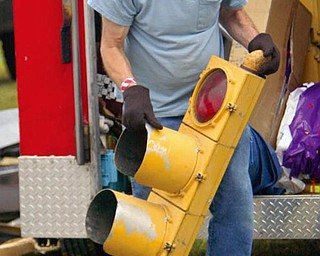 Paul Perelman of Chesterland puts out a traffic light at the Dave and Eds Swap Meet at the Canfield Fairgrounds.