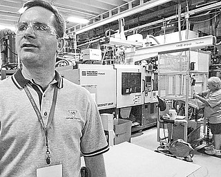 Bryon Osborne, VP Marketing & Sales at Venture Plastics in Newton Falls, at the plant Friday. The company is celebrating 40 years in business.