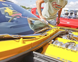 Rex Swartzbeck of Greenville, PA wipes down his 2003 custom Corvette for the collaborative car show with the  Mahoning Valley Corvettes and Greenwood Chevrolet in Austintown, Sunday July 19, 2009Lisa-Ann Ishihara