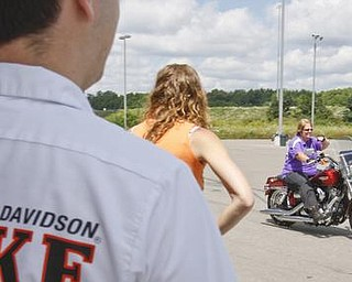 March of Dimes _____ heads out of the Harley-Davidson Biketown parking lot to kick off the event raising money for several charities, SundayJuly 19 2009Lisa-Ann Ishihara