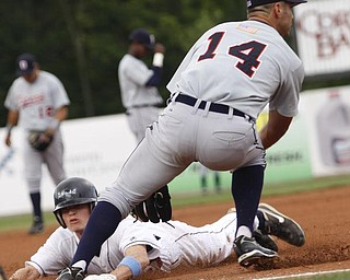 Mahoning Valley Scrappers Jordan Henry (27) makes it safe to 3rd base before Oneonta Tigers Gary Perinar (14) can get him out during the first at Eastwood Field, Sunday July 19, 2009 Lisa-Ann Ishihara