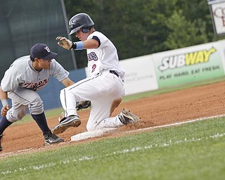 Mahoning Valley Scrappers Kyle Smith (2) slides into 3rd base during the third inning vs Oneonta Tigers Luis Palacios (12) fails to tag him at Eastwood Field, Sunday July 19, 2009 Lisa-Ann Ishihara