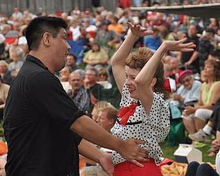 Mineh Ishida, of Cleveland, and Lisa Pitzer, of Newton Falls, dance to Big Bad Voodoo Daddy