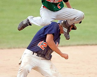 Rondinelli Tuxedo's Phil Lipari jumps over Ohio Hurricane's Joe Chiaroppa after outing him at second base during the fourth inning at Cene Field on Monday evening.