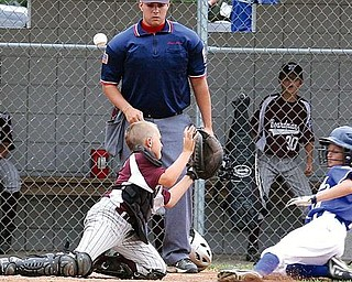 LITTLE LEAGUE - (8) Dylan Kurcov slides in safe as catcher Matt Perham can't come up with the ball and umpire Mike Calcagni looks on Sunday in Boardman. - Special to The Vindicator/Nick Mays