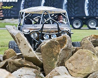 ROCK ON: With his remodeled 2009 Jeep, Brent Goegebuer of 4 Wheel Parts examines the Rock Crawl Challenge set up at the fairgrounds.