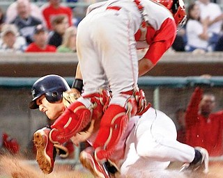 Scrapper Ben Carlson (11) collides into Williamsport Crosscutters catcher Sebastian Valle (9) during the 6th inning at Eastwood Field, Saturday, July 25, 2009.