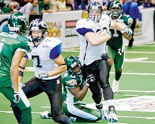 Mahoning Valley Thunder's Jon Loyte (99) drives down the field eventually being brought down by Green Bay Blizzard's Shadrack Okoebor (0) during the third quarter at the Covelli Centre on Saturday evening. Thunder's Jermaine Moye (7) and Blizzard's Tracy Belton (1) seen at left.