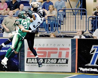 Mahoning Valley Thunder's Frashon McGee (37) catches a touchdown pass while being covered by Green Bay Blizzard's (21) during the fourth quarter at the Covelli Centre on Saturday evening. Thunder's Jermaine Moye (7) and Blizzard's Tracy Belton (1) seen at left.