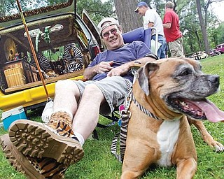 Frank McKinney of Youngstown with his 9 year old boxer Peg sit in front of his 1994 Dodge Caravan decked out in bamboo and various animal print,  for the 15th annual Thunder in the Park presented by the  McDonald Fraternal Order of Police, at Woodland Park in McDonald, Sunday July 26, 2009.