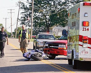 An Officer from Goshen Twp and rescue personnel from the Green Fire Dept.  investigate a crash early this morning on Lisbon Rd. in front of Greenford Christian Chruch that involved a motorcyclist and a car.  The motorcyclist was not there when i arrived and the officer said he was still investigating - robertkyosay