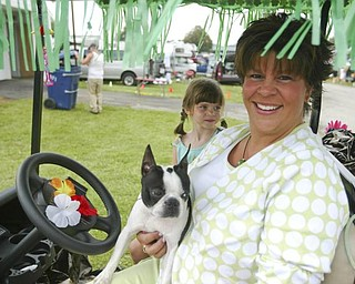 ROCKY -  a Boston Terrier with her owner  Gwen Weyandt and daughter Janee age 6.. on their decorated golf cart.. talk about the dog show and showing - the four day Steel Valley Cluster Dog Show at the Canfield Fairgrounds runs through Sunday - robertkyosay