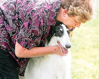 Edna Hanley, of Columbiana, embraces Zoey, a Borzoi, who competed in the Best of Show category of the Steel Valley Cluster Dog Show. The four-day show is at the Canfield Fairgrounds and runs through Sunday.