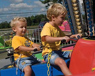 Alex LaPlante, 2, and big brother Nicholas, 5, both of Poland, enjoyed a ride together at the Canfield Fair two years ago.