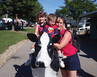 Maddie and Andrew Moran are with their mom, Jill, and their favorite cow at the Canfield Fair.