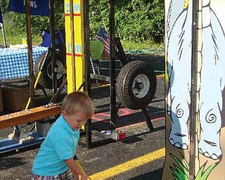 Justin Bish Jr., 2, tries his luck at the Hubbard Founder's Day Festival.