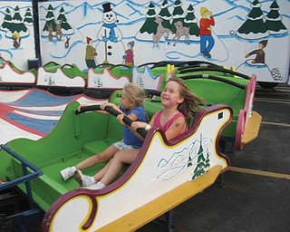 Julianna and Madison Hornikel enjoy this ride at St. Luke's Festival.