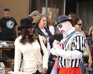 Tina Marie Williams with a clown at the Pig Iron Fest.
