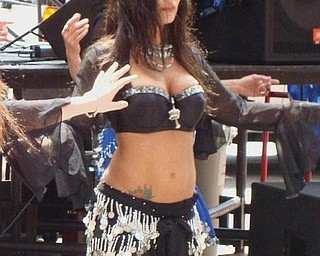 A belly dancer performs at the Pig Iron Fest.