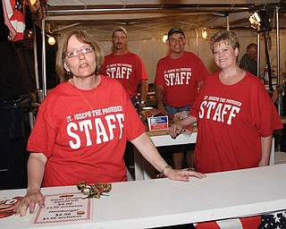 The cooks pictured at St. Joseph the Provider Church Summer Festival in Campbell in June are, from left, Cheryl Jablonski, school principal; John Walczak, athletic director; the Rev. Mike Swierz, pastor; and Julie Cox, cafeteria supervisor.