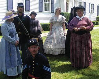 The women of the 61st OVI Company D are getting ready for a fashion show to exhibit dresses of the 1800's (taken by Kayla Windsor).