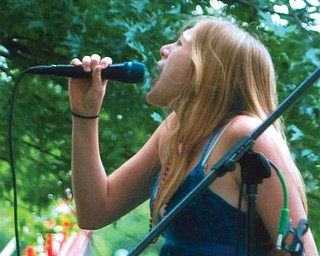 Leanna Hartsough, 16, of Canfield High School performs in the American Idol contest during the Fourth of July festivities in Canfield.