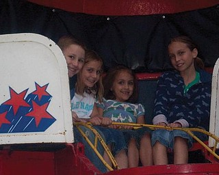 From left are cousins Aaron Gault of Youngstown, Chloe Parker of Charlotte, N.C., Karlynn Riccitelli of Boardman and Quinn Parker of Charlotte as they enjoy riding the Til-a-Whirle together at the McDonald Festival.