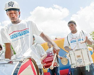 """BIG BEAT: Marcus Surles, 19, left, and Lafay Walden, 17, members of the Tribe of Judah drum line, perform Friday as part of the festivities at the weekend reunion for """"The Brooks"""", in Youngstown."""
