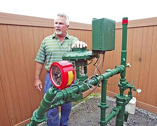Bill siskovic, VP Everflow eastern, stands at a well head near WEst Blvd School in Boardman. wdlewis