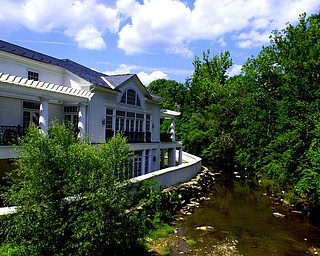 Creek side view of the library from the Main Street Bridge