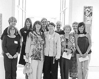 Special to The Vindicator WOMEN ARTISTS: Among the women artists competing in the YWCA's 27 annual Women Artists: A Celebration art show and attending the patron's party, where they received awards, are from left at back, Elaine Green, Karen St. John-Vincent, Maryanne Caleris, Nan Buchanan and Marianne Whitehouse, and in front, Gail Trunick, Rochelle N. Krok, Jo Ann Buzulencia, Mary Kay D'lsa and Merle Bouffard.