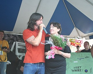 Dave Grohl with his mother, Virginia Grohl, at the David Grohl Alley dedication ceremony in Warren.