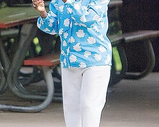 """Geneva Bevly, 82, of Campbell, dances to the music during National Night Out at Wick Park on Tuesday evening. """"I'm getting a little tired but I'm enjoying the music and doing my thing,"""" said Bevly."""