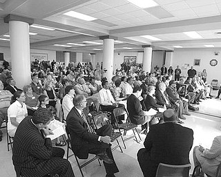 ATTENTIVE AUDIENCE: More than 200 people gather for the Mahoning County Juvenile Court Summit at the Mahoning County High School on Hudson Avenue in Youngstown. In the crowd Tuesday were two congressmen, city, county and state officials, police brass and educational, child advocacy and social service agency leaders.