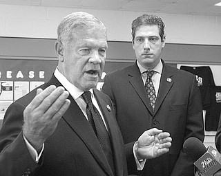 PROMOTING REFORM: U.S. Rep. Charlie Wilson of St. Clairsville, D-6th, left, advocates health-care reform during an impromptu news conference Tuesday in Youngstown. Joining him is U.S. Rep. Tim Ryan of Niles, D-17th.