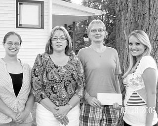 Special to The Vindicator STUDIOUS STUDENTS: Columbiana Area Business and Professional Women's Club presented its 2008-2009 Scholarship Awards to two  area high school students, Kathrine Sacco of Salem High School, at left, and Ashley Thompson of Leetonia High School, at far right. Each girl received a $1,500 scholarship to help defray tuition expenses. Sharing the rewarding moment with the students are, from left, Kimberly Bland, BPW treasurer, and Maryann Pollack, scholarship chair. Annually, for more than 40 years, the BPW has issued scholarships to deserving high school students. The funds are raised at an annual style show luncheon and auction. This year the fundraiser will be at 10:30 a.m. Oct. 24 at Salem Golf Club. Local businesses interested in donating items for the auction can contact Lori Libb at (330) 853-5896 or at the Bahama Bay Tanning Salon in Salem.
