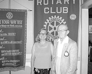 Special to The Vindicator PERFECT ATTENDANCE: During a recent meeting of Youngstown Rotary Club, Mary Womble, club president, took the opportunity to congratulate Henry Bertolini, who was recognized for his 62 years of perfect attendance at club meetings.