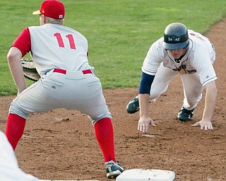 Scrappers Kyle Bellows dives back to 1rst ahead of the throw. Cyclones 1st baseman is Sam Honeck.