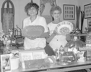 Special to The Vindicator OUT OF SORTS: Items are being carefully sorted by, from left, Sofia Froom and Dot Leo, who are part of a committee involved in preparing the collection for a sale to take place from 10 a.m. to 4 p.m. Friday and Saturday at the barn on the property at the Ward-Thomas Museum, 503 Brown St., Niles. Clothing, rugs, household items, books, lawn mowers and other equipment will be available for bargain hunters. Hot dogs and pop will also be sold. Proceeds will benefit Niles Historical Society and will be used for the upkeep of the museum and grounds. For more information call the museum, (330) 544-2143.