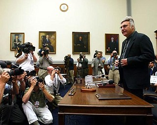 Rep. James Traficant, D-Ohio, arrives on Capitol Hill in Washington, Monday, July 15, 2002 to testify before the House Ethics Committee. In an uphill fight to keep from becoming only the second House member expelled from Congress since the Civil War, Traficant opens his second defense this week against the bribery, tax evasion and racketeering charges he was convicted of in court.