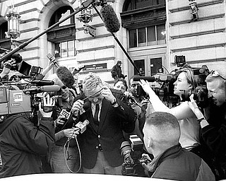 Jim Traficant ducks under media cables while leaving federal court April 4, 2002, after being found guilty.