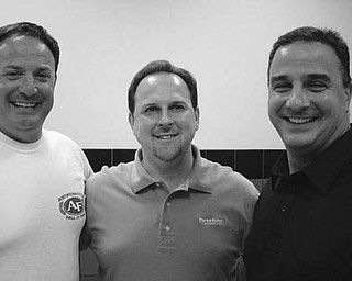 Special to The Vindicator WELCOMED: After the Aug. 3 meeting of Austintown Growth Foundation, from left, Tim Kelty, chairman of Fitch Athletic Hall of Fame; David Ditzler, foundation president; and Vincent S. Colaluca, new superintendent of Austintown Local School District, enjoyed time together. Colaluca spoke of the new middle school, which has changed the academic advantages for students with modern methods of teaching, and of future plans for the school district. Kelty, who was instrumental in starting the Athletic Hall of Fame in Austintown, announced that inductees will be introduced Sept. 25 before the game and honored at a dinner at Immaculate Heart of Mary Parish Center; cost is $60.