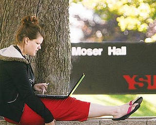 ENROLLMENT UP: Freshman Rachel Clifton of Hubbard, took a moment between classes to check her schedule as Youngstown State University. University officials said first-day enrollment Monday for the fall semester reached 14,425, the highest number in 16 years.