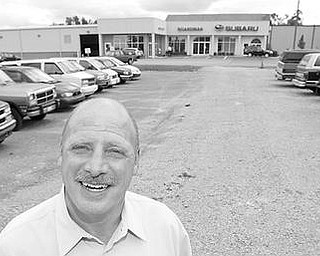 OLDIES BUT NOT SUCH GOODIES: Rob Fellman, owner of Boardman Subaru and vice president of the Auto Dealers Association of Eastern Ohio, said the Cash-for-Clunkers program was a big success. He is standing in front of some of the clunkers he took in on trade from customers who cashed in on the $3,500 to $4,500 the government was offering to new car buyers. A lot of the trade-ins were almost worthless, he said.
